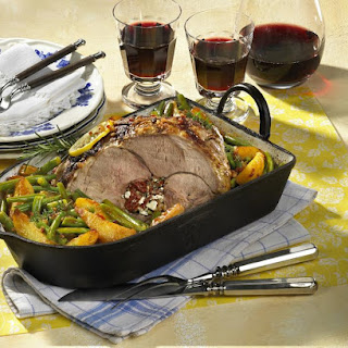 Mediterranean Stuffed Roast Lamb with Green Beans and Fried Potatoes.
