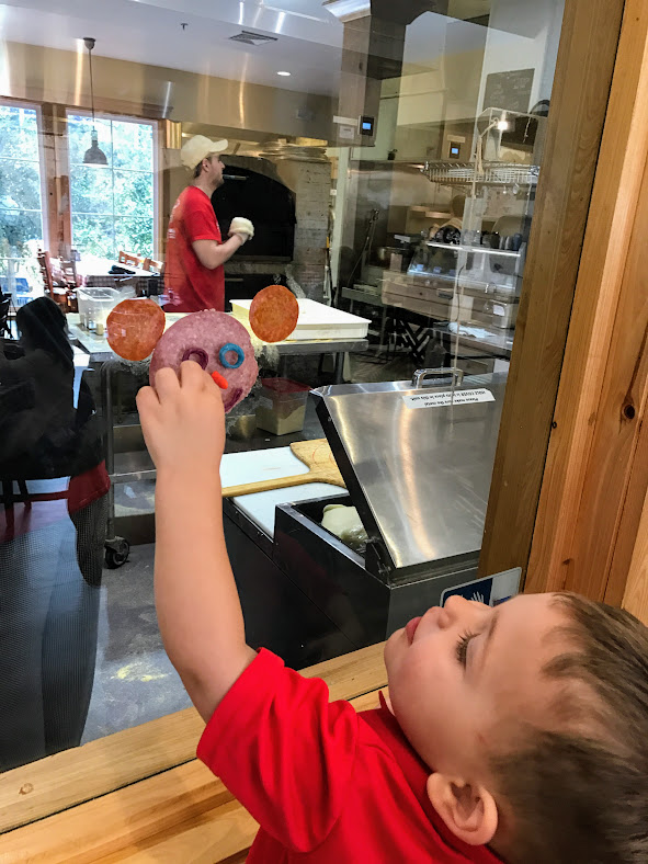 On the 15th we went to a pizza place in Biloxi for Peyton's birthday. The guys in the kitchen placed some salami and pepperoni on the inside glass for Logan to decorate.