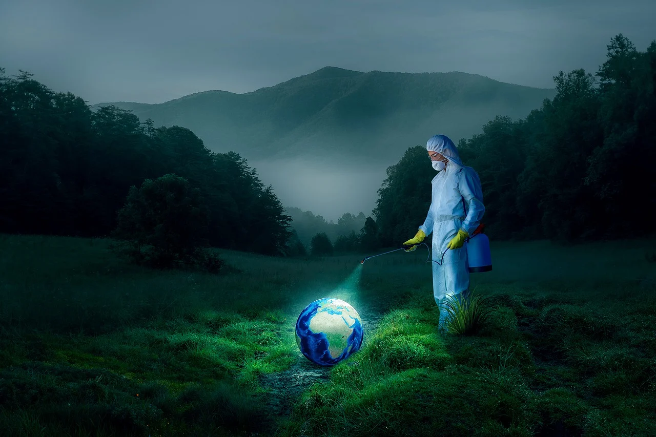 Man sanitizing the planet earth in digitally created image
