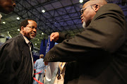 ACDP leader Kenneth Meshoe chats with the ANC's Gwede Mantashe chats with at IEC's results centre in Pretoria.