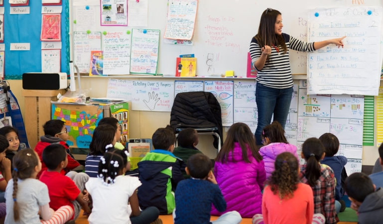 a teacher leads her class in a lesson at a San Francisco public school