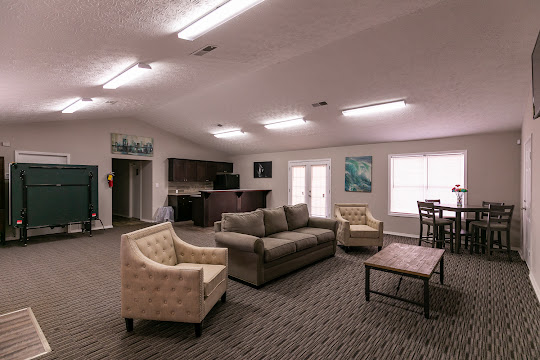 Clubhouse with couch and chairs and common space