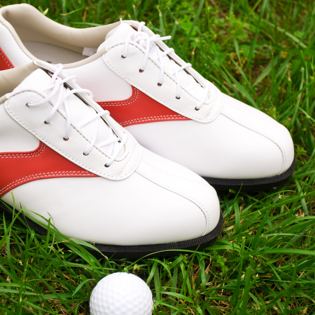 A pair of youth golf shoes.
