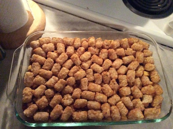 Top with velveeta, then tater tots.(Tots do not have to be in single layer.)...