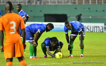 Photo: Julius Wobay, Kei Kamara and Alhadji Kamara prepare for a free kick in the last 10 minutes  [Leone Stars v Ivory Coast, 6 September 2014 (Pic © Darren McKinstry / www.johnnymckinstry.com)]