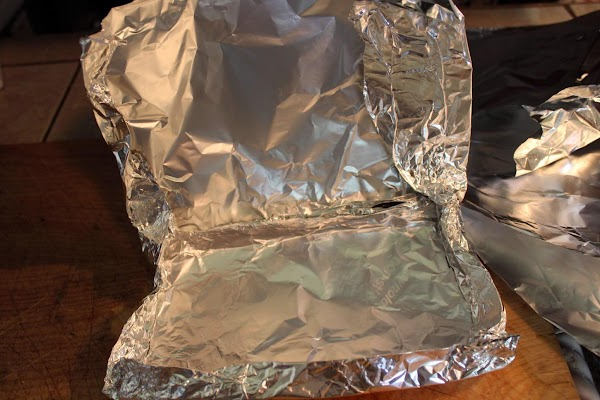 Large pieces of aluminum foil folded together.