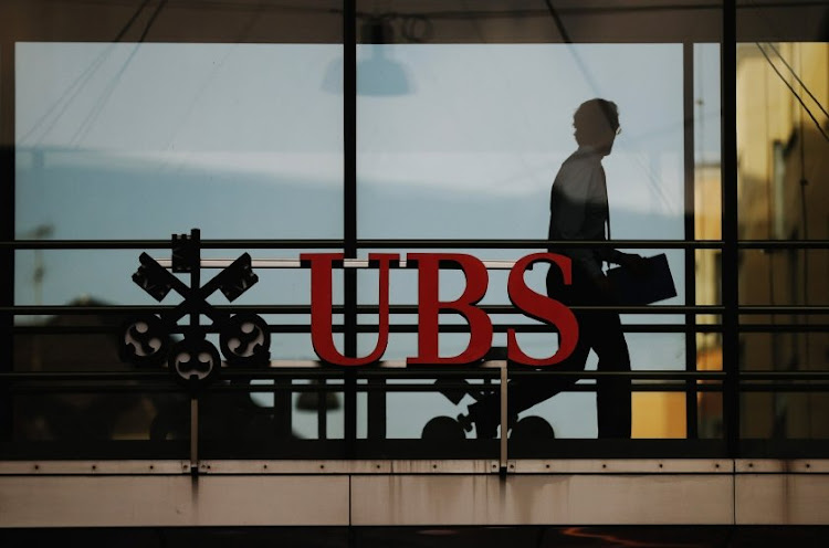 An employee walks past a logo of Swiss bank UBS in Zurich. Picture: REUTERS