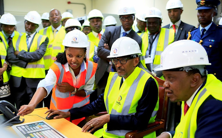 Rwanda's President Paul Kagame (seated, 2nd right) and his host Kenya's President Uhuru Kenyatta (seated on right) sit in the control room at the official commissioning of a KenGen 140MW Olkaria geothermal power plant in Naivasha, Kenya in February.  Picture: REUTERS