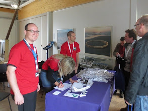 Photo: Eico, Angi & Joachim meet us at Registration... from then on they are humorously known as the RedShirts! :)