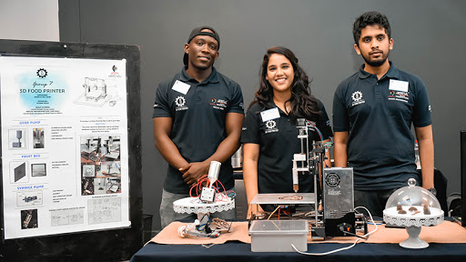 Nzuzo Nene, Divya Naidoo and Aravind Arunakirinathar with their 3D food printer during the design process.