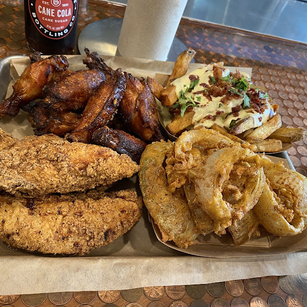 All of this is gluten free!  Only fry gf items so fryer is safe!  So delicious.  This is the tenders, wings, loaded fries and onion rings.