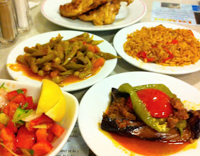 Photo: Our first meal in Istanbul was like a meat-n-three in the south! Roasted chicken, stewed okra, orzo rice, stuffed eggplant with pepper and minded meat, tomato and cucumber salad.