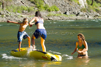 "Photo: Young women and a boy having ""ducky wars"" while whitewater rafting on the Main Salmon River in central Idaho."