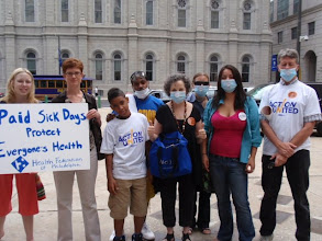 Photo: ACTION United members and members of the Health Federation of Philadelphia stand outside City Hall on the day of the victory.