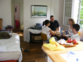 Photo: A look at our home for the week, with the gang playing cards in the main area. Kitchen and bathroom areas are behind the camera, and the two bedrooms in the back. It's cozy, but congenially Parisian, and we adapt well to it.