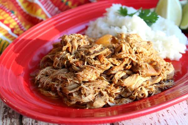 Shredded Chicken On A Red Plate With Rice.
