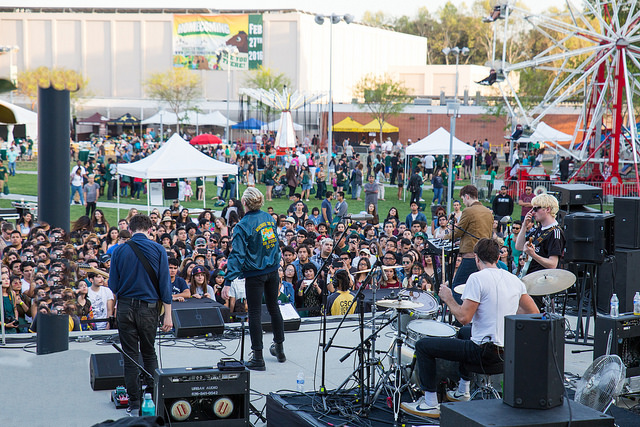 A shot from behind The Drums paying to a large crowd at Homecoming at Bronco Commons.
