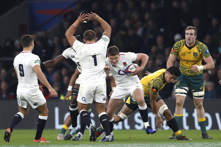 England's fly-half Owen Farrell (C) makes a break during the international rugby union test match between England and Australia at Twickenham stadium in south-west London on November 24, 2018.