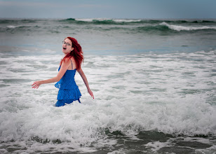 Photo: The Girly in Red  Here's our girl this weekend before the transition to her neon pink hair. We went to the beach so we thought it would be fun to have some fun getting some photos. At this point she realized she was getting in deep and that her dress was getting soaked. As you can tell by the look on her face she didn't care much. We're definitely raising a free spirit.