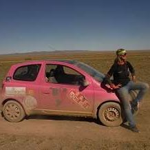 The Pink Yak and Krystal in Mongolia covered in Dirt