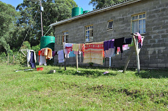Photo: The teen girls house with laundry drying and the water tanks in view. these are filled both by rain gutters catching rain and thru wells.