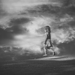 Where The Sky Begins by Julie Moses - Babies & Children Child Portraits ( child, girl, dramtic sky, black and white, outdoor )