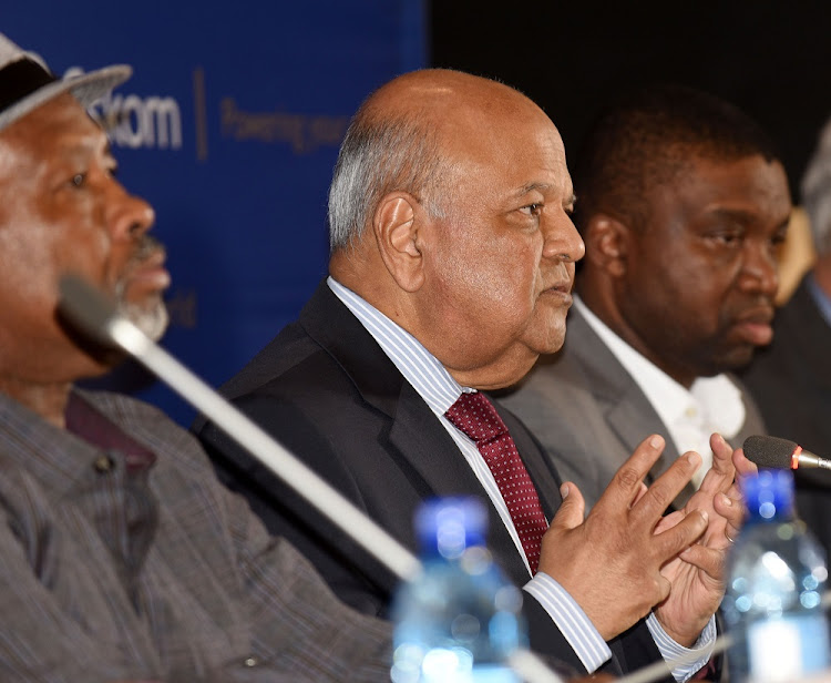 Eskom chair Jabu Mabuza, public enterprises minister Pravin Gordhan and Thuto Shomang, acting director of Eskom, address a media briefing at Megawatt Park in Johannesburg, December 6 2018. Picture: FREDDY MAVUINDA