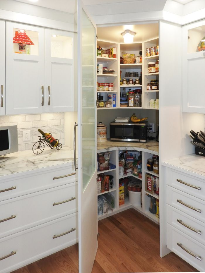 white shaker kitchen with closed corner pantry for extra storage