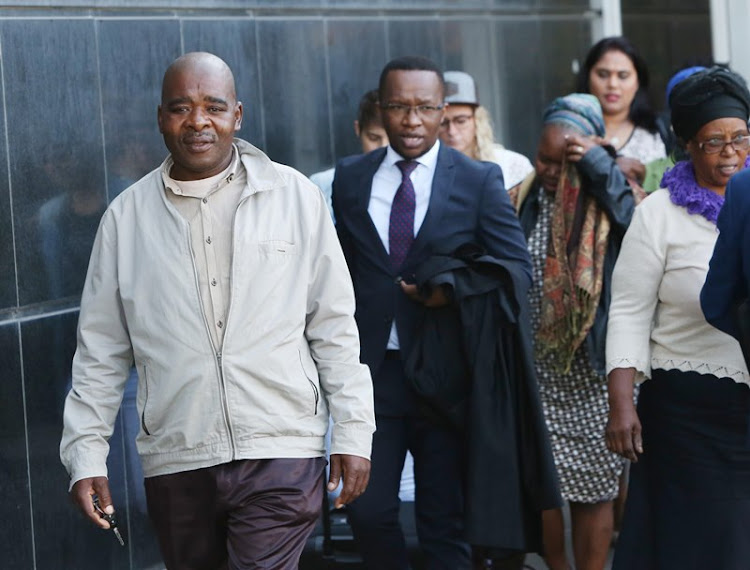 Baby Siwaphiwe's mother Sibongile Mbambo follows her her husband Christopher Mbambo and attorney Mfanafuthi Biyela out the the Durban magistrates court.