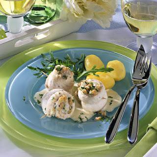 Stuffed Sole Rolls in White Wine Sauce.