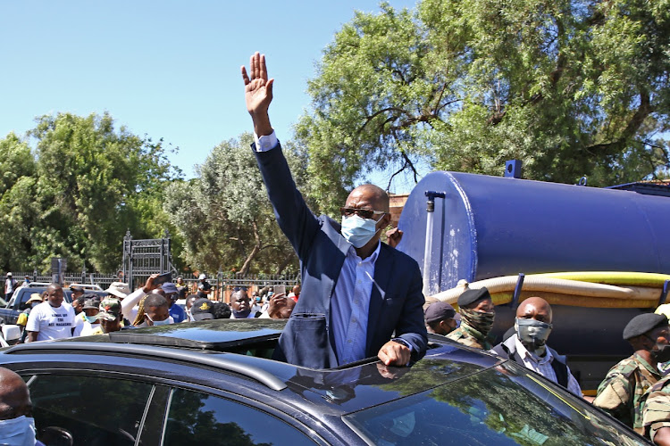 Ace Magashule waves at supporters after appearing in the Bloemfontein magistrate's court on charges of fraud and money laundering in connection with the R255m Free State asbestos tender scandal. The Supreme Court of Appeal delivered another blow to him on Wednesday.