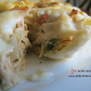 Slow Cooked Chicken Stuffed Pasta With Roasted Garlic Cream Sauce.
