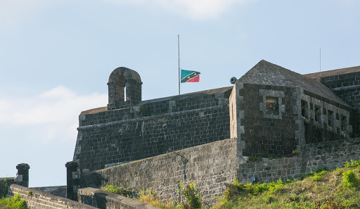 Brimstone-Hill-Fortress-5.jpg - The St. Kitts flag flies at half staff over Brimstone Hill Fortress on St. Kitts.