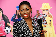 Singer Lira poses with the Barbie doll that was created in her image as part of Barbie's 60th anniversary and the doll-maker's Shero campaign.