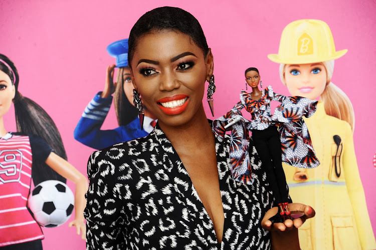 Singer Lira poses with the Lira Barbie that was created in her image as part of Barbie's 60th anniversary Shero campaign.