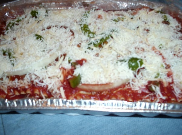 Add lasagna noodle in the pan and cover with sauce.  Next take the...