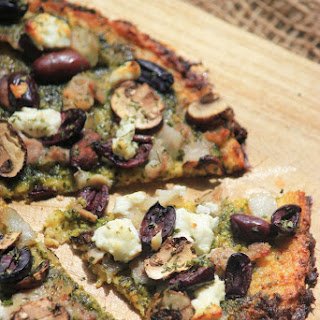 Cauliflower Pesto Pizza with Olives and Goat Cheese