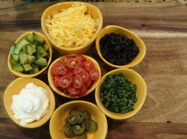 PREPARE TOPPINGSChop your tomatoes, green onions, olives and avocado.  You will need sour...