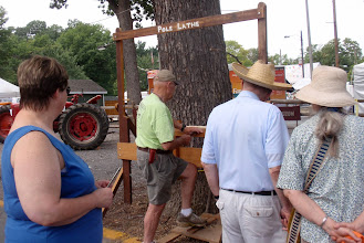 Photo: Bob demos the pole lathe that he helped build!