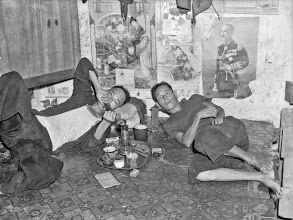Photo: Photographer: Harrison Forman Singapore, men smoking in opium den, 1941