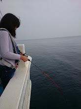 """Photo: 去年の半日ジギングでヒラスを釣った """"七海ちゃん""""! 今年も夏休みを利用してご乗船。 そして、ヒーット! ・・・でしたがバレちゃいました"""