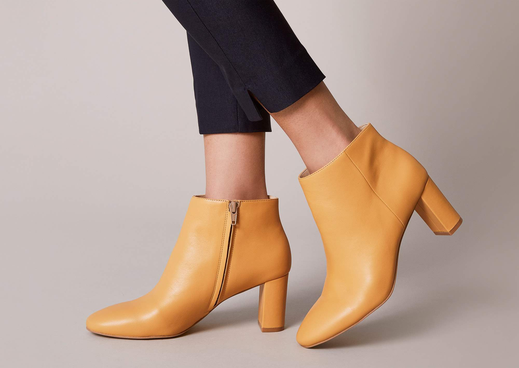 Tan leather boots for business casual outfit