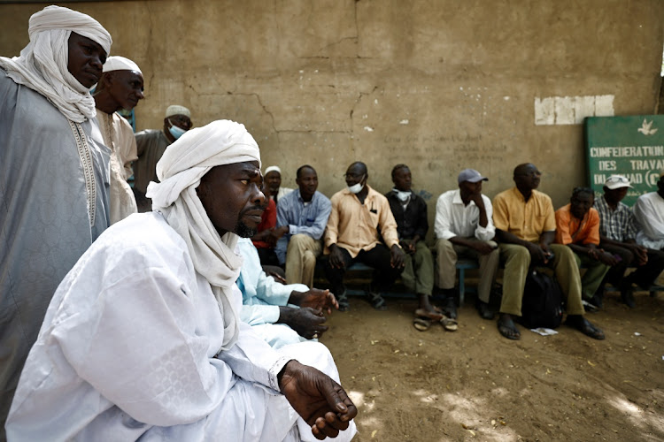 Jobless men wait outside an employment office in N'djamena, Chad, April 26 2021. Picture: ZOHRA BENSEMRA/REUTERS