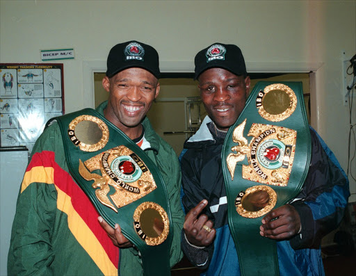 Mpush Makambi IBO middleweight champion with Peter Malinga welterweight IBO champion here they brandish their belts after Makambi successfully defended his crown while Malinga won a vacant title in Coventry in London on 23 October 1999. Pic by Mxolisi Ntshuca