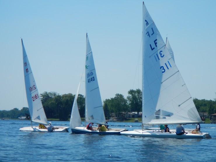 Three different boat designs, MC Scow, Rebel, C Scow