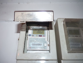 Photo: Beijing - electricity meter after I came home monday evening since electricity stopped working on Sunday lunch and I've got electricity prepaid card and slept one night in company, on right side slot for inserting electricity card to transfer data from charged card with money/kWh after what should be electricity start working, but when I got to home someone already charged electricity so I didn't have opportunity to try it and have to wait for next time, this is fresh counter I guess with total amount of kWh since??, photo taken 111128
