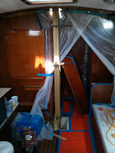 Photo: 2X8's chocked into mast buckets and parteners to serve as an snchor for sliding the motor forward into the galley
