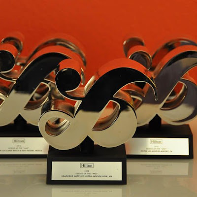 3d printing gallery image of a chrome plated resin trophy in the shape of an ampersand sign used at a hilton corporate event gala