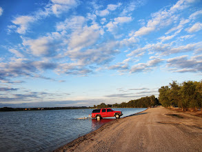 Photo: Red truck in a lake under a beautiful sky at Easwood Park in Dayton, Ohio.