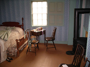 Photo: another bedroom, with trundle bed seen peeking out from under the main bed.